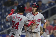 Bryce Harper #34 of the Washington Nationals celebrates with Trea Turner #7 after hitting a two run home run in the top of the first inning against the Philadelphia Phillies at Citizens Bank Park on September 12, 2018 in Philadelphia, Pennsylvania.