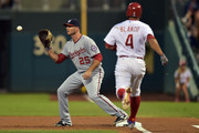 Clint Robinson #25 of the Washington Nationals puts out Andres Blanco #4 of the Philadelphia Phillies in the first inning at Citizens Bank Park on September 16, 2015 in Philadelphia, Pennsylvania.
