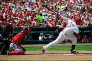 Matt Holliday #7 of the St. Louis Cardinals hits a sacrifice fly during the fifth inning against the Washington Nationals at Busch Stadium on June 15, 2014 in St. Louis, Missouri.
