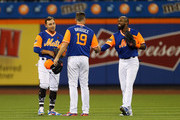 Jay Bruce #19 of the New York Mets is congratulated by fellow outfielders Michael Conforto #30 and Austin Jackson #16 after defeating the Washington Nationals 3-0 during a game at Citi Field on August 24, 2018 in the Flushing neighborhood of the Queens borough of New York City.