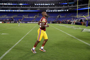 Adrian Peterson #26 of the Washington Redskins jogs off the field following a preseason game against the Baltimore Ravens at M&T Bank Stadium on August 30, 2018 in Baltimore, Maryland.