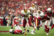 Running back Adrian Peterson #26 of the Washington Redskins runs past linebacker Deone Bucannon #20 of the Arizona Cardinals during the first half at State Farm Stadium on September 9, 2018 in Glendale, Arizona.