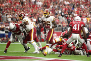Running back Adrian Peterson #26 of the Washington Redskins scores a one-yard touchdown during the second quarter against the Arizona Cardinals at State Farm Stadium on September 9, 2018 in Glendale, Arizona.