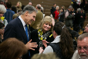 """Washington governor Jay Inslee (L) and his wife Trudi Inslee greet attendees during the """"Together Evening of Prayer"""" event at Haller Middle School on April 4, 2014 in Arlington, Washington.  Hundreds of people attended the """"Together Evening of Prayer"""" to pay respect to the victims of a massive mudslide that ravished the town of Oso, Washington killing at least 30 people and leaving many missing."""