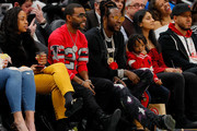 Comedian and singer Lil Duval sits alongside of rapper 2 Chainz as the watch the game between the Atlanta Hawks and the Washington Wizards at State Farm Arena on December 18, 2018 in Atlanta, Georgia.  NOTE TO USER: User expressly acknowledges and agrees that, by downloading and or using this photograph, User is consenting to the terms and conditions of the Getty Images License Agreement.