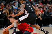 Jeremy Lin #7 of the Atlanta Hawks draws a foul as he dives for a loose ball against Bradley Beal #3 of the Washington Wizards at State Farm Arena on December 18, 2018 in Atlanta, Georgia.  NOTE TO USER: User expressly acknowledges and agrees that, by downloading and or using this photograph, User is consenting to the terms and conditions of the Getty Images License Agreement.