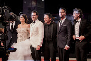 "Penelope Cruz, wearing Atelier Swarovski Fine Jewellery, Edgar Ramírez, Gael García Bernal, Wagner Moura and Leonardo Sbaraglia walk the red carpet ahead of the ""Wasp Network"" screening during the 76th Venice Film Festival at Sala Grande on September 01, 2019 in Venice, Italy."