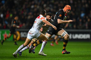 Kearnan Myall of Wasps takes on Ben Youngs and Michael Fitzgerald of Leicester Tigers during the Aviva Premiership match between Wasps and Leicester Tigers at The Ricoh Arena on December 2, 2017 in Coventry, England.