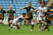 Josh Bassett of Wasps is tackled by Ben Youngs during the Gallagher Premiership Rugby match between Wasps and Leicester Tigers at the Ricoh Arena on September 16, 2018 in Coventry, United Kingdom.