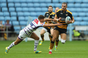 Josh Bassett of Wasps moves past Ben Youngs during the Gallagher Premiership Rugby match between Wasps and Leicester Tigers at the Ricoh Arena on September 16, 2018 in Coventry, United Kingdom.
