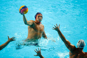 Jesse Smith (blue) of United States takes a shot during the Men's quarter final match between Serbia and United States on day eleven of the 16th FINA World Championships at the Water Polo Arena on August 4, 2015 in Kazan, Russia.