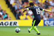 Santi Cazorla of Arsenal scores his sides first goal during the Premier League match between Watford and Arsenal at Vicarage Road on August 27, 2016 in Watford, England.