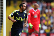Santi Cazorla of Arsenal celebrates scoring his sides first goal during the Premier League match between Watford and Arsenal at Vicarage Road on August 27, 2016 in Watford, England.