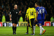Referee Mike Dean speaks with the players during the Barclays Premier League match between Watford and Chelsea at Vicarage Road on February 3, 2016 in Watford, England.