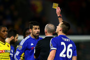 Referee Mike Dean shows the yellow card to Diego Costa of Chelsea during the Barclays Premier League match between Watford and Chelsea at Vicarage Road on February 3, 2016 in Watford, England.