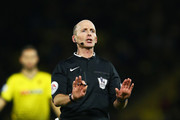 Referee mike dean in action during the Barclays Premier League match between Watford and Chelsea at Vicarage Road on February 3, 2016 in Watford, England.