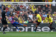Troy Deeney of Watford clears a shot from Mamadou Sakho of Crystal Palace during the Premier League match between Watford and Crystal Palace at Vicarage Road on April 21, 2018 in Watford, England.