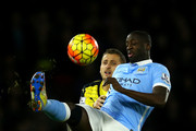 Yaya Toure of Manchester City holds off Almen Abdi of Watford during the Barclays Premier League match between Watford and Manchester City at Vicarage Road on January 2, 2016 in Watford, England.