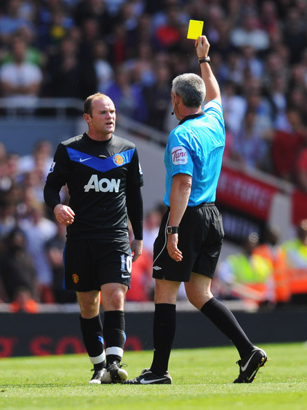 Wayne Rooney Referee Chris Foy shows a yellow card to Wayne Rooney of Manchester United as he is booked during the Barclays Premier League match between Arsenal and Manchester United at the Emirates Stadium on May 1, 2011 in London, England.