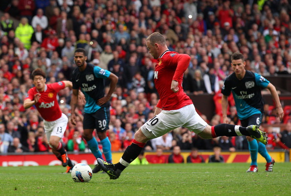 Wayne Rooney Wayne Rooney of Manchester United scores his third goal from the penalty spot during the Barclays Premier League match between Manchester United and Arsenal at Old Trafford on August 28, 2011 in Manchester, England.
