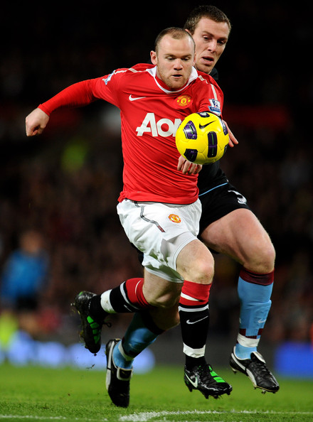 Wayne Rooney Wayne Rooney of Manchester United beats Richard Dunne of Aston Villa to the ball prior to scoring the opening goal during the Barclays Premier League match between Manchester United and Aston Villa at Old Trafford on February 1, 2011 in Manchester, England.