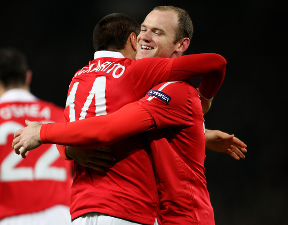 Wayne Rooney Javier Hernandez (L) of Manchester United celebrates scoring the opening goal with teammate Wayne Rooney during the UEFA Champions League round of 16 second leg match between Manchester United and Marseille at Old Trafford on March 15, 2011 in Manchester, England.