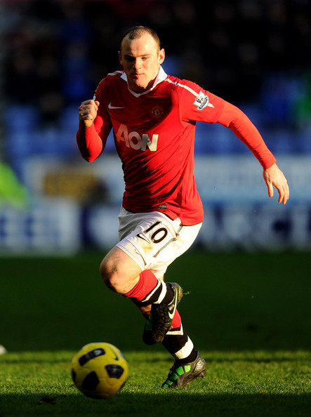 Wayne Rooney Wayne Rooney of Manchester United in action during the Barclays Premier League match between Wigan Athletic and Manchester United at the DW Stadium on February 26, 2011 in Wigan, England.