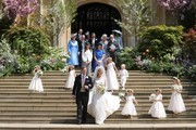 Newlyweds Mr Thomas Kingston and Lady Gabriella Windsor walk down on the steps of the chapel with their bridesmaids, page boys and guests after their wedding at St George's Chapel on May 18, 2019 in Windsor, England.