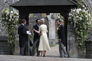 Spencer Matthews, second left, is greeted by Donna Air as James Middleton, right, looks on at the entrance of St Mark's Church ahead of the wedding of Pippa Middleton and James Matthews on May 20, 2017  in Englefield, England. Middleton, the sister of Catherine, Duchess of Cambridge is to marry hedge fund manager James Matthews in a ceremony Saturday where her niece and nephew Prince George and Princess Charlotte are in the wedding party, along with sister Kate and princes Harry and William.