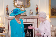 Queen Elizabeth II holds an audience with Dame Marguerite Pindling upon her appointment as Governor-General of the Commonwealth of the Bahamas and invested her with the Insignia of a Dame Grand Cross of the Most Distinguished Order of St Michael and St George at Buckingham Palace on October 14, 2014 in London, England.