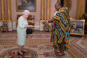Queen Elizabeth II  receives His Excellency, Mr Victor Emmanuel Smith who presented his Letters of Commission as High Commissioner for the Republic of Ghana at Buckingham Palace, on October 15, 2014 in London, England.