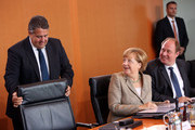 (L to R) Vice Chancellor and Economy and Energy Minister Sigmar Gabriel (SPD), German Chancellor Angela Merkel (CDU) and Minister of State Helge Braun (CDU) arrive for the weekly German federal Cabinet meeting on August 13, 2014 in Berlin, Germany. High on the meeting's agenda was discussion over a draft proposal about European Union policies for citizens' protection against violence as well as other legislation against manipulation in sports betting.