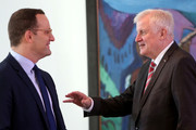 Interior Minister Horst Seehofer (CSU, R) speaks to Health Minister Jens Spahn (CDU) as they arrive for the weekly German federal Cabinet meeting on September 26, 2018 in Berlin, Germany. High on the meeting's agenda was discussion of improving patient health care services.