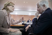 Agriculture and Consumer Protection Minister Julia Kloeckner (L) speaks with Interior Minister Horst Seehofer (R) before the German government cabinet meeting on September 5, 2018 in Berlin, Germany. High on the morning's agenda was proposed legislation to deal with the period after the United Kingdom's departure from the European Union, or Brexit.