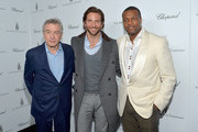 (L-R) Actors Robert De Niro, Bradley Cooper, and Chris Tucker attend The Weinstein Company and Chopard's Academy Award Party in association with Grey Goose at Soho House on February 23, 2013 in West Hollywood, California.