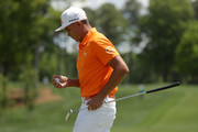 Rickie Fowler inspects his golf ball following his putt on the first green during the final round of the 2018 Wells Fargo Championship at Quail Hollow Club on May 6, 2018 in Charlotte, North Carolina.
