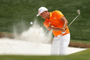 Rickie Fowler plays a shot from a bunker on the first hole during the final round of the 2018 Wells Fargo Championship at Quail Hollow Club on May 6, 2018 in Charlotte, North Carolina.
