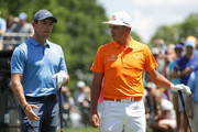 Rory McIlroy(L) of Northern Ireland and Rickie Fowler stand on the first tee during the final round of the 2018 Wells Fargo Championship at Quail Hollow Club on May 6, 2018 in Charlotte, North Carolina.