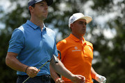 Rory McIlroy(L) of Northern Ireland and Rickie Fowler walk off the sixth tee during the final round of the 2018 Wells Fargo Championship at Quail Hollow Club on May 6, 2018 in Charlotte, North Carolina.