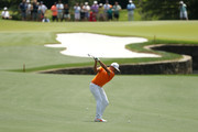 Rickie Fowler plays his second shot on the seventh hole during the final round of the 2018 Wells Fargo Championship at Quail Hollow Club on May 6, 2018 in Charlotte, North Carolina.
