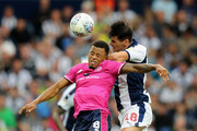 Gareth Barry of West Bromwich Albion out jumps Jordan Cousins during the Sky Bet Championship match between West Bromwich Albion and Queens Park Rangers at The Hawthorns on August 18, 2018 in West Bromwich, England.