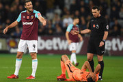 Andy Carroll of West Ham United reacts as Emre Can of Liverpool lies injured during the Premier League match between West Ham United and Liverpool at London Stadium on November 4, 2017 in London, England.