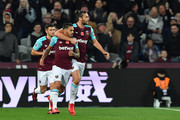 West Ham United's Argentinian midfielder Manuel Lanzini (L) celebrates with West Ham United's English striker Andy Carroll after scoring during the English Premier League football match between West Ham United and Liverpool at The London Stadium, in east London on November 4, 2017. / AFP PHOTO / Ben STANSALL / RESTRICTED TO EDITORIAL USE. No use with unauthorized audio, video, data, fixture lists, club/league logos or 'live' services. Online in-match use limited to 75 images, no video emulation. No use in betting, games or single club/league/player publications.  /