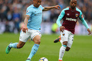 Gabriel Jesus of Manchester City is challenged by Patrice Evra of West Ham United during the Premier League match between West Ham United and Manchester City at London Stadium on April 29, 2018 in London, England.