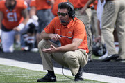 Mike Gundy head coach of the Oklahoma State Cowboys calls plays against West Virginia during the second half of a NCAA football game at Boone Pickens Stadium October 29, 2016 in Stillwater, Oklahoma. Oklahoma State defeated #10 West Virginia 37-10.