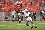 Braxton Miller #1 of the Ohio State Buckeyes leaps to avoid the tackle attempt from Ronald Zamort #7 of the Western Michigan Broncos in the fourth quarter at Ohio Stadium on September 26, 2015 in Columbus, Ohio. Ohio State defeated Western Michigan 38-12.