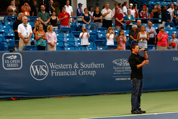 TV personality Nick Lachey performs the National Anthem before the evening match between Marion Bartoli of France and Kim Clijsters of Belgium during Day 1 of the Western & Southern Financial Group Women's Open on August 10, 2009 at the Lindner Family Tennis Center in Cincinnati, Ohio.