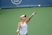 Sabine Lisicki of Germany hits a serve during her match against Saisai Zheng of China during the Western & Southern Open at the Lindner Family Tennis Center on August 14, 2016 in Mason, Ohio.