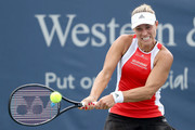 Angelique Kerber of Germany returns a shot to Anett Kontaveit of Estonia during the Western & Southern Open at Lindner Family Tennis Center on August 13, 2019 in Mason, Ohio.