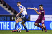 Dan Burn of Wigan Athletic is challenged by Sergio Aguero of Manchester City during the Emirates FA Cup Fifth Round match between Wigan Athletic and Manchester City at DW Stadium on February 19, 2018 in Wigan, England.